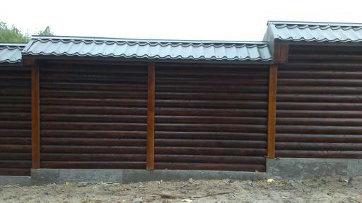 Комбинированный деревянный забор из оцилиндрованного бруса купить